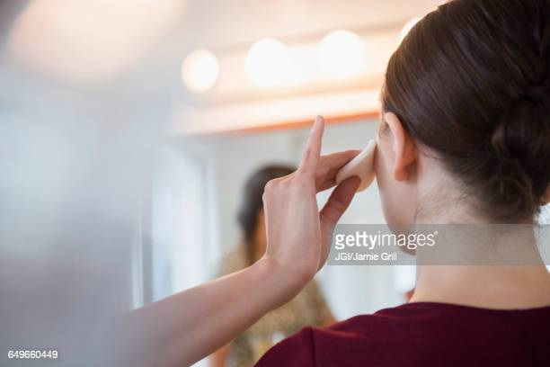 woman having makeup applied by stylist - padding stock pictures, royalty-free photos & images