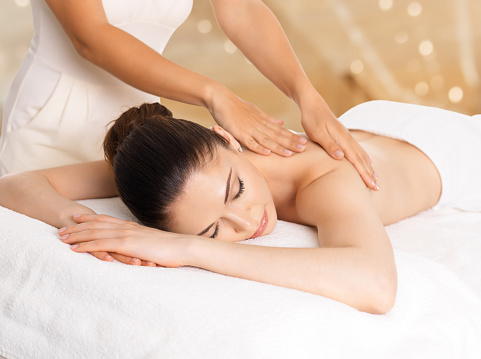 Woman having massage of body in spa salon 528067688