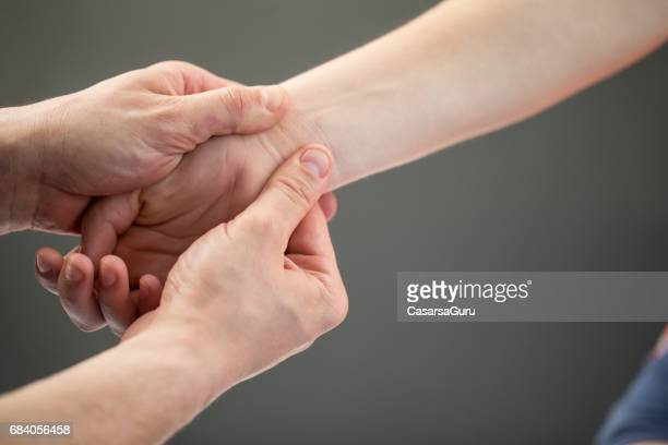 woman having myofascial release therapy to prevent hand tightness - releasing stock pictures, royalty-free photos & images