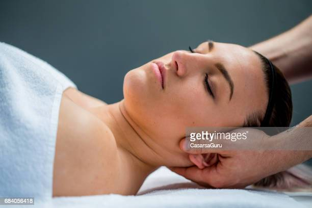 Woman Having Myofascial Release Therapy To Prevent Neck And Back Pain