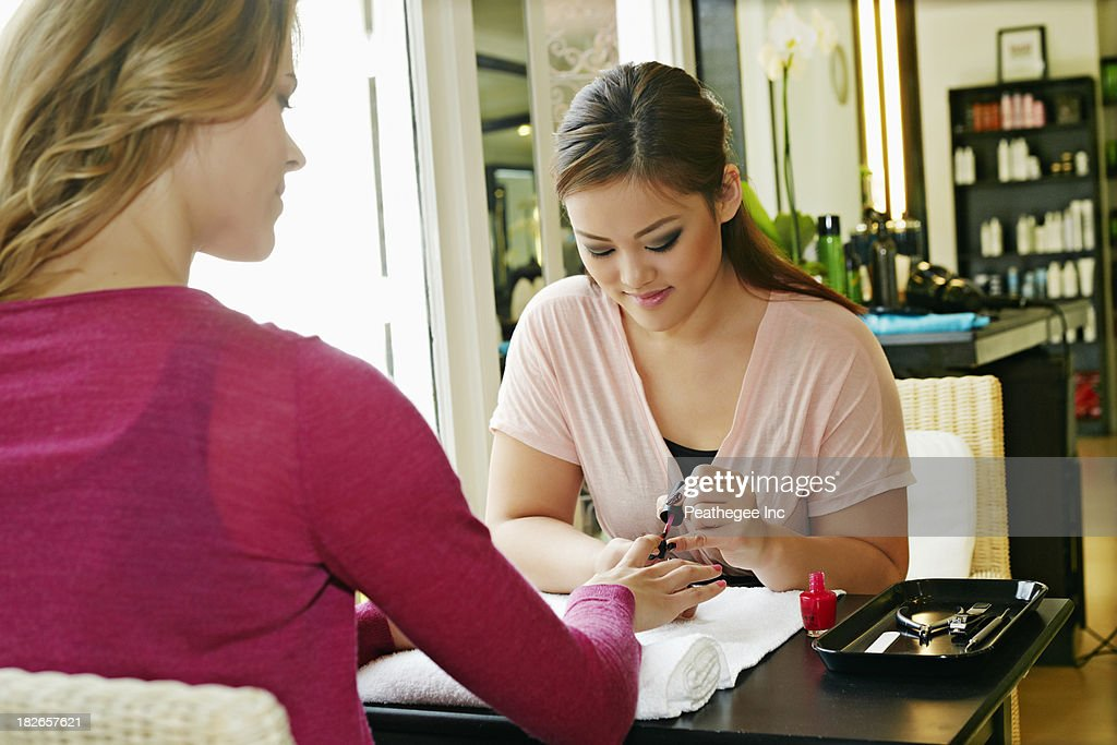 Woman having nails done in salon : Stock Photo
