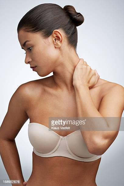 Woman having neck pain (front view)