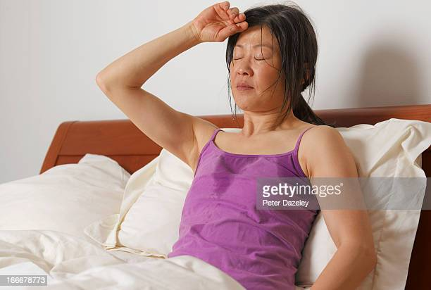 woman having night sweats - pneumonia stock pictures, royalty-free photos & images