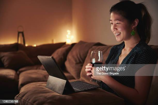 woman having online date with boyfriend - online dating stock pictures, royalty-free photos & images