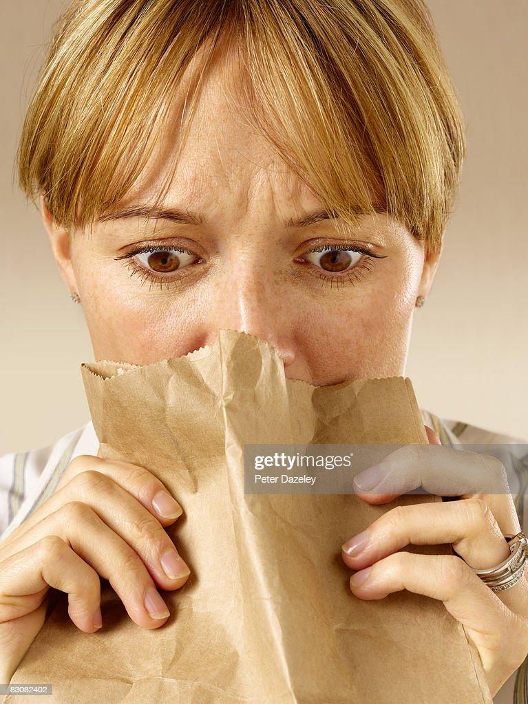 Woman having panic attack : Stock Photo