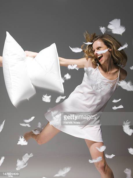 Woman having pillow fight