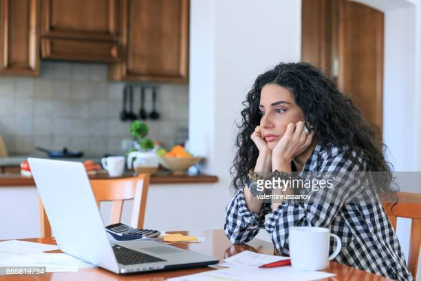 Woman having problems with home bills