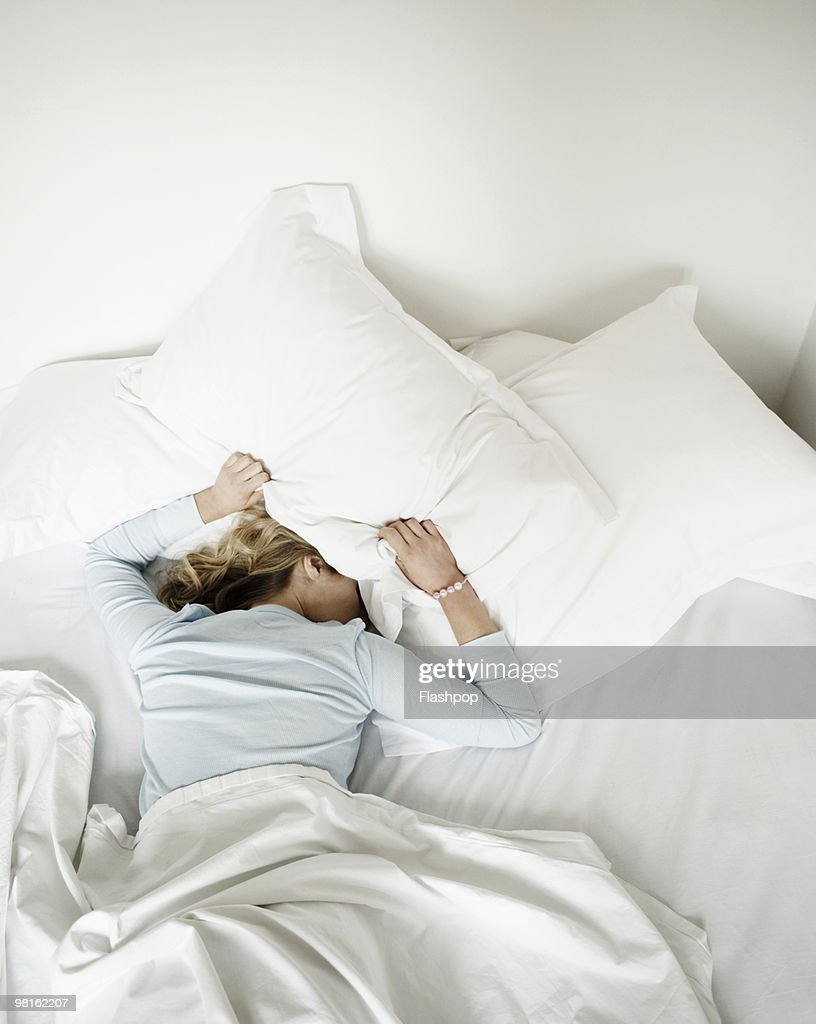 Woman having restless nights sleep : Stock Photo
