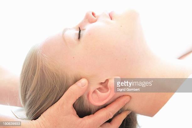 woman having scalp massage in spa - sigrid gombert stock-fotos und bilder