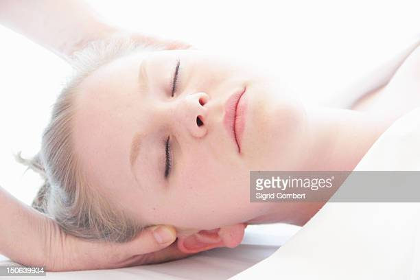 woman having scalp massage in spa - sigrid gombert stock pictures, royalty-free photos & images