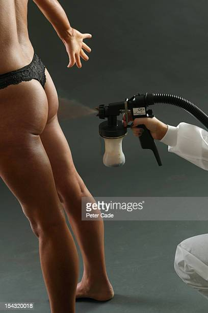 Woman having spray tan