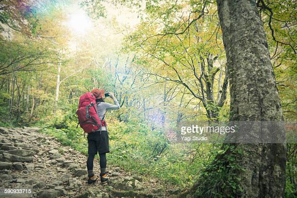 Woman having taken the mountain photo of a smartph