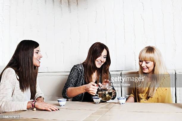 woman having tea at a sushi bar. - female friendship stock pictures, royalty-free photos & images