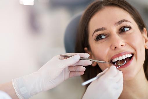 Woman having teeth examined at dentists 936887200