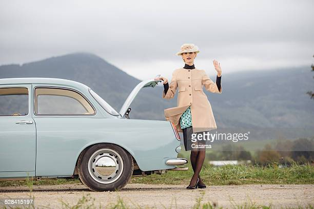 woman having trouble with her car - vintage auto repair stock pictures, royalty-free photos & images