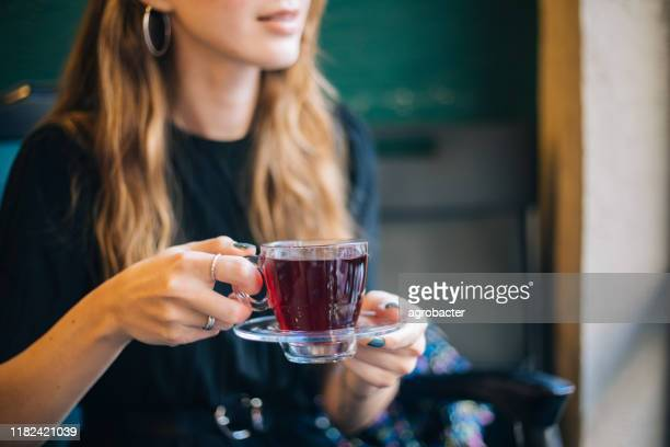 woman having winter tea at coffee - herbal tea stock pictures, royalty-free photos & images