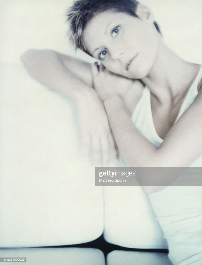Woman, head leaning on a chair. : Stockfoto