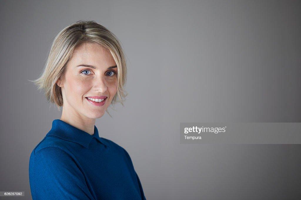 Woman headshot looking at camera. : Stock Photo
