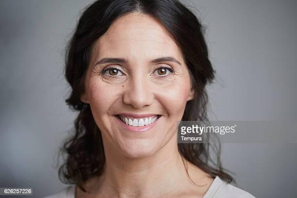 Woman headshot looking at camera.