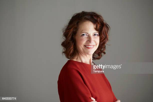 woman headshot looking at camera. - ginger stock photos and pictures