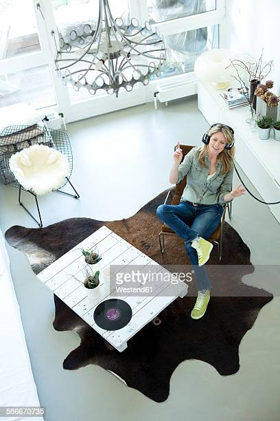 Woman hearing music with headphones at home