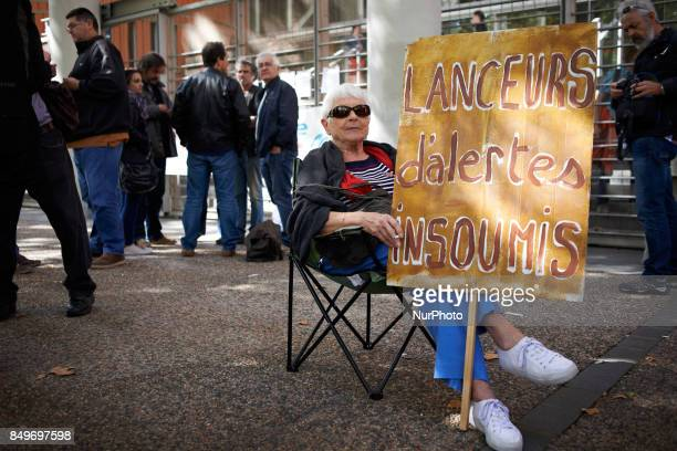 A woman held a placard reading 'Unbowed whistleblower' in support of Celine Boussie French whistleblower and president of the association...
