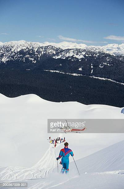 Woman heli skiing, Whistler Mountain, British Columbia, Canada, elevated view