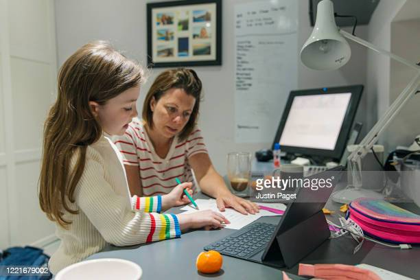 woman helping daughter with her home schooling - studying stock pictures, royalty-free photos & images