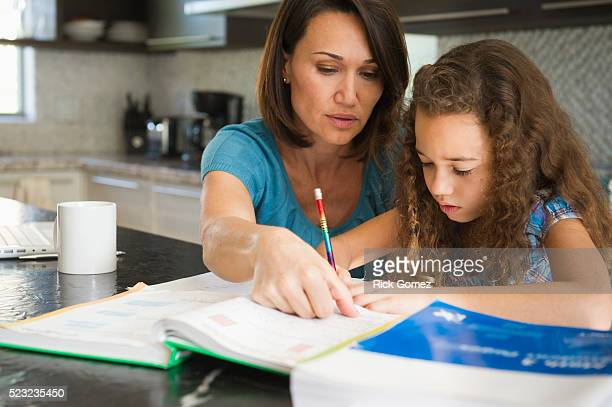 woman helping daughter with her studies - homeschool stock pictures, royalty-free photos & images
