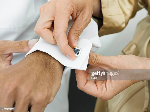 Woman Helping Man with Cuff Links
