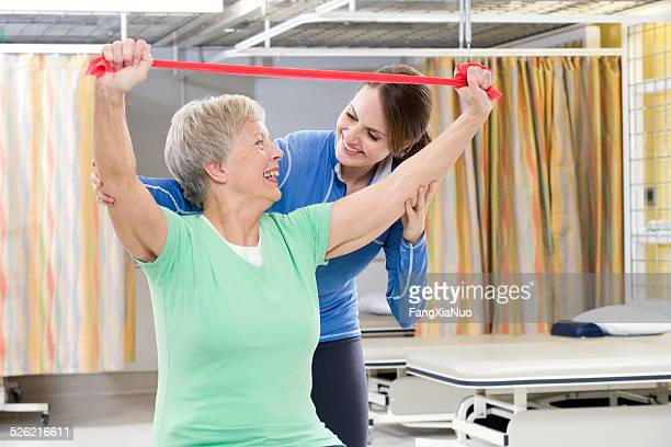 Woman Helping Woman in Rehabilitation Center