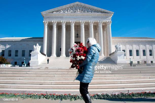 A woman helps lay 3000 carnations to represent the approximated 3000 abortions that occur in the US every day on the 46th anniversary of the Roe v...