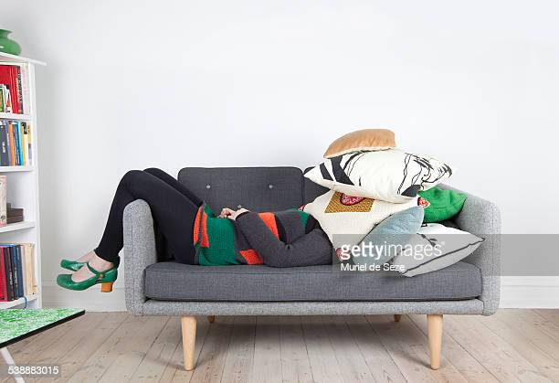 Woman hidden by pillows