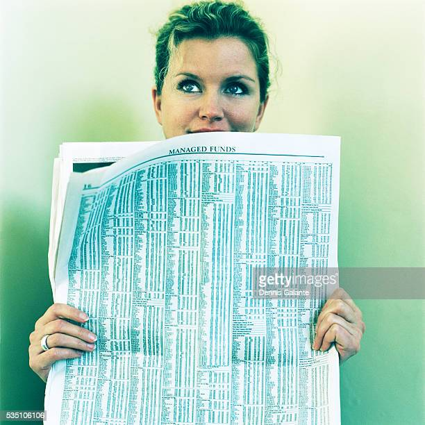 Woman Hiding Behind Newspaper