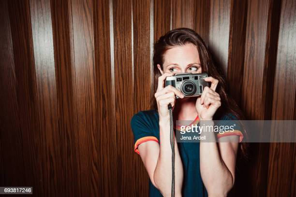 Woman Hiding Face Behind Camera