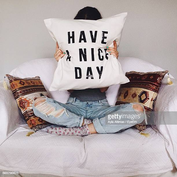 Woman Hiding Face From Pillow With Text