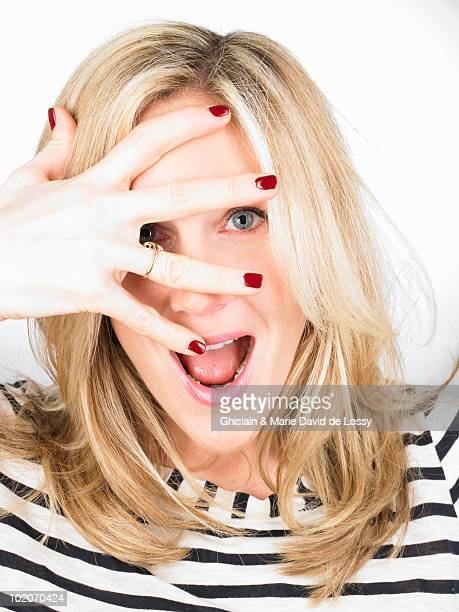 Woman hiding her eyes with her hand