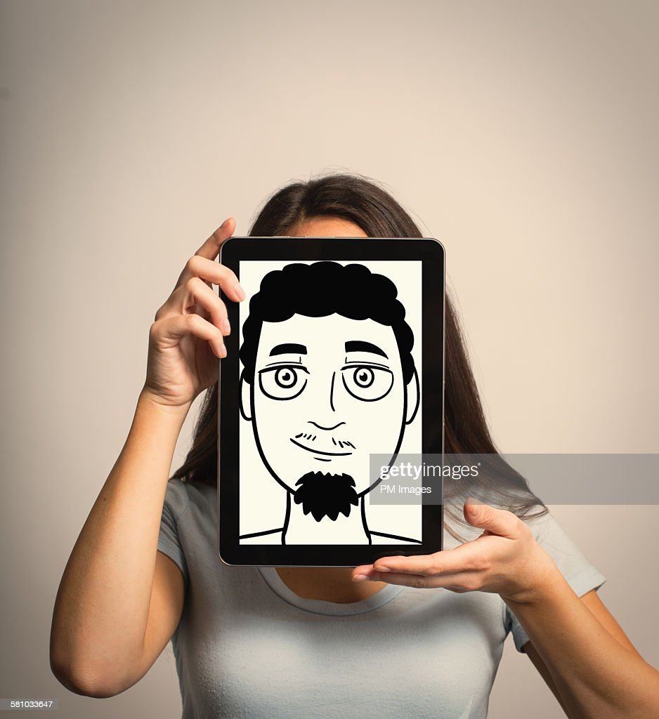 Woman hiding identity with tablet : Stock Photo