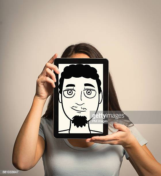 Woman hiding identity with tablet