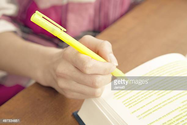 Woman highlighting a passage in a book