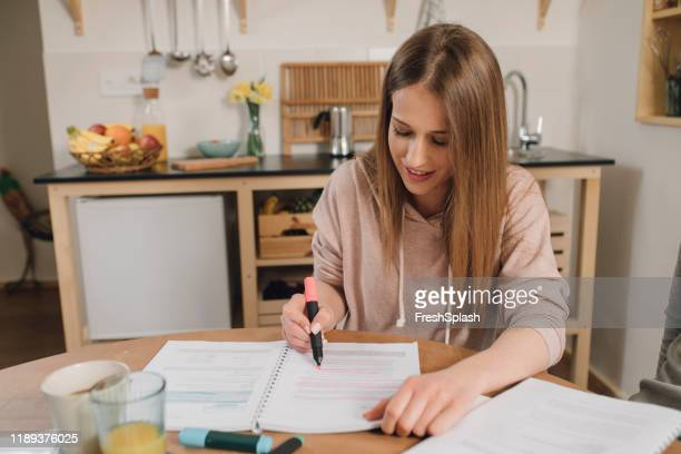 woman highlighting text - highlights stock pictures, royalty-free photos & images