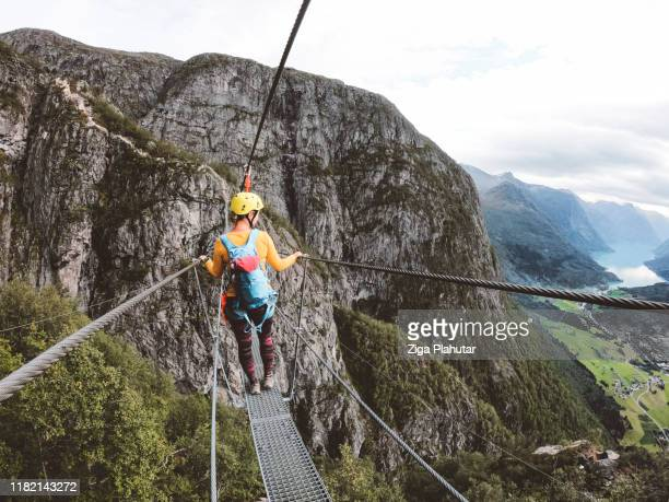 woman hiker enjoying the view - loen, norway - norway stock pictures, royalty-free photos & images