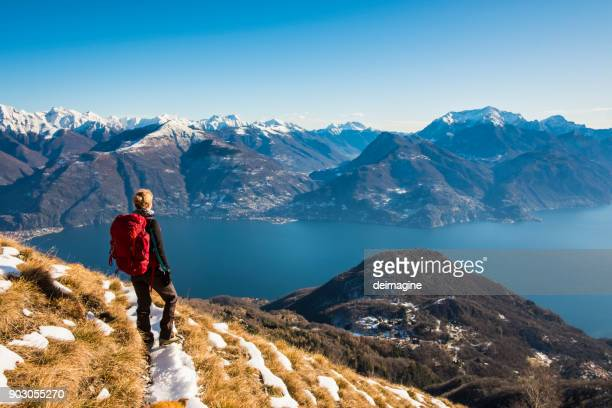 Woman hiker on mountain looking at lake