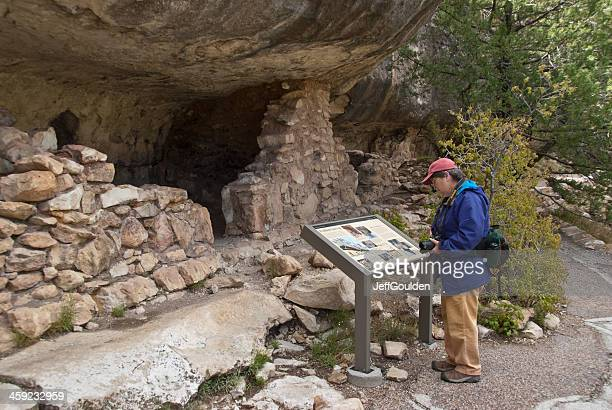 Woman Hiker Viewing the Ruins of an Ancient Cliff Dwelling
