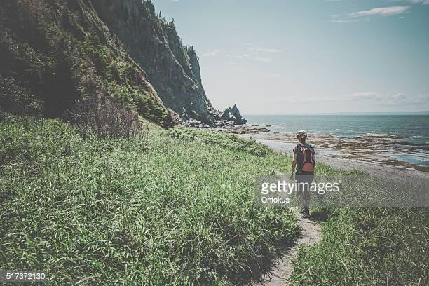 Woman Hiker Walking on a Trail