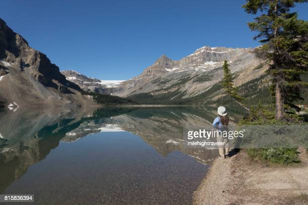 woman hikes bow lake banff national park alberta canada glacier - milehightraveler stock pictures, royalty-free photos & images
