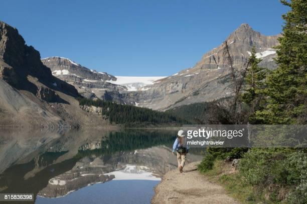 Woman hikes Bow Lake Banff National Park Alberta Canada glacier