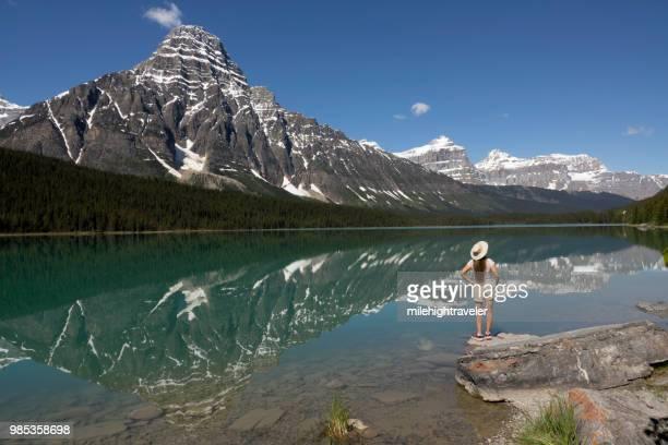 Woman hikes explores Waterfowl Lake Mount Chephren Banff National Park Alberta Canada