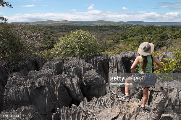 Woman hikes through Ankarana Reserve Tsingy rock formations Madagascar
