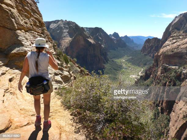 woman hikes zion national park desert angels landing trail utah - waist pack stock pictures, royalty-free photos & images
